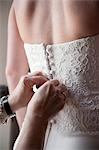 Hands Buttoning Bride's Gown Stock Photo - Premium Rights-Managed, Artist: Ikonica, Code: 700-03519141