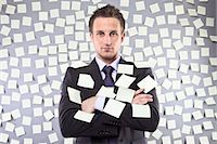 Businessman Covered in Self Adhesive Notes Stock Photo - Premium Royalty-Freenull, Code: 600-03520296
