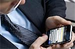 Businessman Using Smartphone Stock Photo - Premium Rights-Managed, Artist: Burazin, Code: 700-03520331