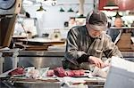 Man Working at Tsukiji Central Wholesale Market, Tokyo, Japan Stock Photo - Premium Rights-Managed, Artist: Ikonica, Code: 700-03520458