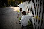Boys Walking Beside White Picket Fence, Sauble Beach, Ontario, Canada Stock Photo - Premium Rights-Managed, Artist: Kristin Sjaarda, Code: 700-03520592