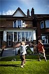 Children Chasing Bubbles on Front Lawn, Toronto, Ontario, Canada Stock Photo - Premium Rights-Managed, Artist: Derek Shapton, Code: 700-03520599
