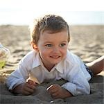Boy Playing Lying in Sand, Sauble, Beach, Ontario Stock Photo - Premium Rights-Managed, Artist: Derek Shapton, Code: 700-03520602