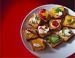 Various Appetizers on Mini Toast Slices Stock Photo - Premium Royalty-Free, Artist: Klick, Code: 659-03520920