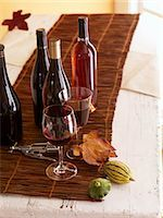 Bottles and Glasses of Wine with Corkscrew Stock Photo - Premium Royalty-Freenull, Code: 659-03521252