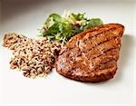 Grilled Steak with Wild Rice and Salad on White Stock Photo - Premium Royalty-Free, Artist: Photocuisine, Code: 659-03521448
