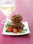 Two meatballs on tomato with herbs Stock Photo - Premium Royalty-Freenull, Code: 659-03521918