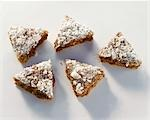 Gingerbread triangles sprinkled with meringue Stock Photo - Premium Royalty-Freenull, Code: 659-03522172