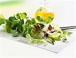 Mixed salad with Parmesan, bottle of oil in background Stock Photo - Premium Royalty-Freenull, Code: 659-03522230