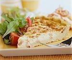 A piece of quiche with salad Stock Photo - Premium Royalty-Free, Artist: foodanddrinkphotos, Code: 659-03522379