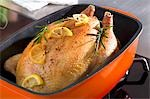Roast chicken with rosemary and lemon Stock Photo - Premium Royalty-Freenull, Code: 659-03522624