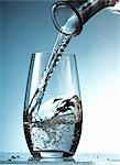 Pouring water into a glass Stock Photo - Premium Royalty-Free, Artist: Photocuisine, Code: 659-03522848