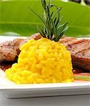 Saffron risotto served with roast duck breast Stock Photo - Premium Royalty-Freenull, Code: 659-03523135