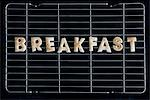 Toast letters spelling the word BREAKFAST on a rack Stock Photo - Premium Royalty-Free, Artist: foodanddrinkphotos, Code: 659-03523136