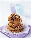 Chocolate chip cookies, stacked on paper Stock Photo - Premium Royalty-Free, Artist: Amy Whitt, Code: 659-03523977