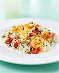 Fried, diced chicken breast on rice with tomatoes Stock Photo - Premium Royalty-Freenull, Code: 659-03523993