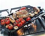 Sausages, mushrooms and tomatoes in a grill frying pan Stock Photo - Premium Royalty-Free, Artist: Photocuisine, Code: 659-03524014