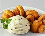 Breaded fried mushrooms with remoulade sauce Stock Photo - Premium Royalty-Free, Artist: Westend61, Code: 659-03524236