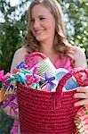 Woman holding basket of decorations for a garden party Stock Photo - Premium Royalty-Free, Artist: Kevin Dodge, Code: 659-03524316