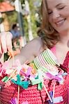 Woman holding basket of decorations for a garden party Stock Photo - Premium Royalty-Free, Artist: Kevin Dodge, Code: 659-03524317