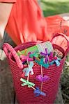 Basket of decorations for a garden party, woman in background Stock Photo - Premium Royalty-Free, Artist: Kevin Dodge, Code: 659-03524318