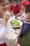 Young people with popcorn and salad at a barbecue Stock Photo - Premium Royalty-Free, Artist: Kevin Dodge, Code: 659-03524335