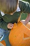 Small boy making pumpkin lantern Stock Photo - Premium Royalty-Freenull, Code: 659-03524992