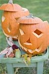 Carved pumpkin faces on garden table Stock Photo - Premium Royalty-Freenull, Code: 659-03524996