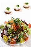 Mixed salad and goat's cheese on rounds of bread Stock Photo - Premium Royalty-Freenull, Code: 659-03525364