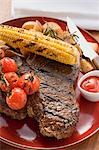 Grilled steak, corn on the cob, cherry tomatoes, potatoes, ketchup Stock Photo - Premium Royalty-Free, Artist: CulturaRM, Code: 659-03526967