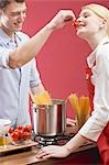 Couple cooking spaghetti with tomatoes Stock Photo - Premium Royalty-Free, Artist: Photocuisine, Code: 659-03527431