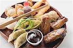 Plate of Asian appetisers with dip Stock Photo - Premium Royalty-Freenull, Code: 659-03527671
