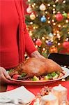Woman serving roast duck (Christmas) Stock Photo - Premium Royalty-Free, Artist: Westend61, Code: 659-03528313