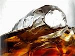 Glass of cola with ice cubes (close-up) Stock Photo - Premium Royalty-Free, Artist: Glowimages, Code: 659-03528469