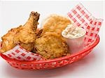 Fried chicken with coleslaw and scone in plastic basket Stock Photo - Premium Royalty-Freenull, Code: 659-03528592
