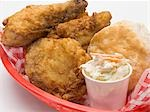 Fried chicken with coleslaw and scone in plastic basket Stock Photo - Premium Royalty-Freenull, Code: 659-03528593