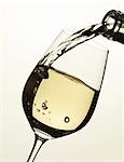 Pouring white wine into glass Stock Photo - Premium Royalty-Free, Artist: foodanddrinkphotos, Code: 659-03528915