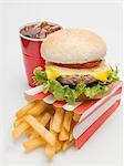 Cheeseburger, chips and cola Stock Photo - Premium Royalty-Free, Artist: Ikon Images, Code: 659-03529173