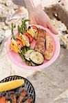 Hand holding plate of grilled food Stock Photo - Premium Royalty-Free, Artist: Kevin Dodge, Code: 659-03529508