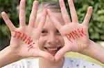 Girl showing her hands with the words THINK PINK Stock Photo - Premium Royalty-Free, Artist: ableimages, Code: 659-03529580