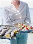 Woman holding trays of fish & kebabs ready for grilling, outdoors Stock Photo - Premium Royalty-Free, Artist: Kevin Dodge, Code: 659-03529665