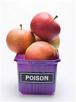 poison - Red apples in a plastic punnet with a 'POISON' label Stock Photo - Premium Royalty-Freenull, Code: 659-03529690