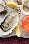 Fresh oysters with lemon and tomato dip Stock Photo - Premium Royalty-Freenull, Code: 659-03530398