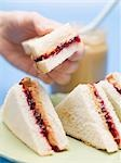 Hand holding peanut butter and jelly sandwich Stock Photo - Premium Royalty-Free, Artist: foodanddrinkphotos, Code: 659-03530530