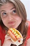 Pensive woman with hot dog Stock Photo - Premium Royalty-Free, Artist: ableimages, Code: 659-03531201