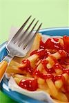 Fork lying beside chips with ketchup Stock Photo - Premium Royalty-Freenull, Code: 659-03531337