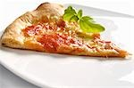 A slice of pizza with basil Stock Photo - Premium Royalty-Freenull, Code: 659-03531661
