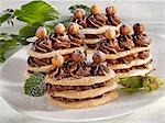 Towers of sponge, gianduia cream and hazelnuts Stock Photo - Premium Royalty-Free, Artist: Ron Fehling, Code: 659-03532039