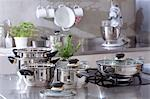 Assorted stainless steel pans in a kitchen Stock Photo - Premium Royalty-Free, Artist: Photocuisine, Code: 659-03533721