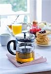 Teapot, toast and orange juice on a breakfast table Stock Photo - Premium Royalty-Free, Artist: foodanddrinkphotos, Code: 659-03533723